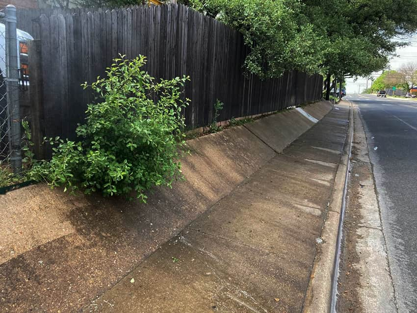 Pressure Washing Austin TX before wall at Georgian Dr
